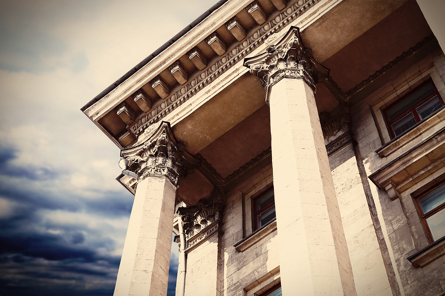 Courthouse facade with columns. Vintage style filter